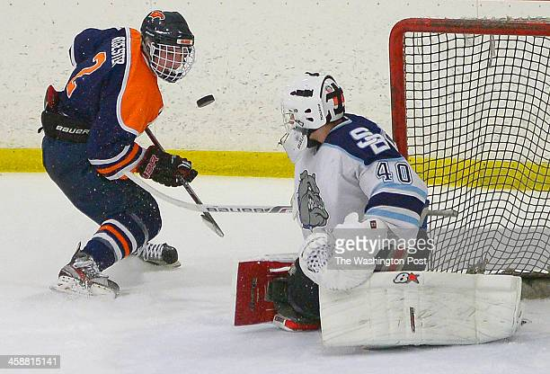 Briar Woods' Zach Regester left has his 3rd period penalty shot blocked by Stone Bridge goalie Colin McNelis as Stone Bridge defeats Briar Woods in...