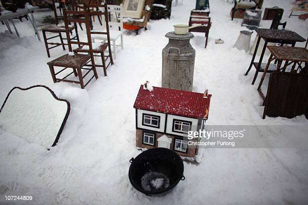 Bricabrac and antiques lay on the snow covered ground as traders and bargain hunters brave the Arctic weather to attend the Newark International...