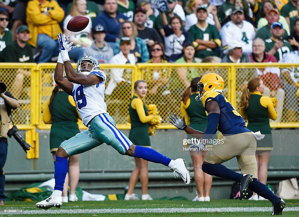 Brice Butler #19 of the Dallas Cowboys catches a touchdown pass under pressure from Micah Hyde #33 of the Green Bay Packers during the second quarter at Lambeau Field on October 16, 2016 in Green Bay, Wisconsin.