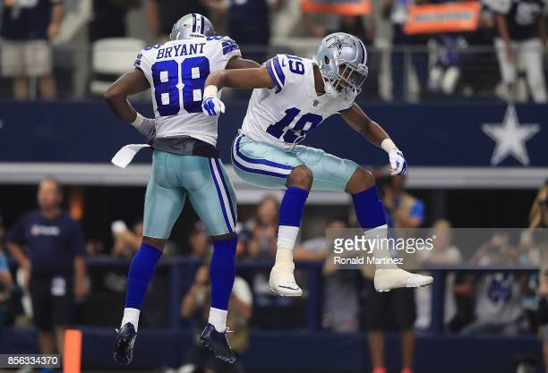 Brice Butler of the Dallas Cowboys celebrates his touchdown with Dez Bryant in the second quarter against the Los Angeles Rams at ATT Stadium on...