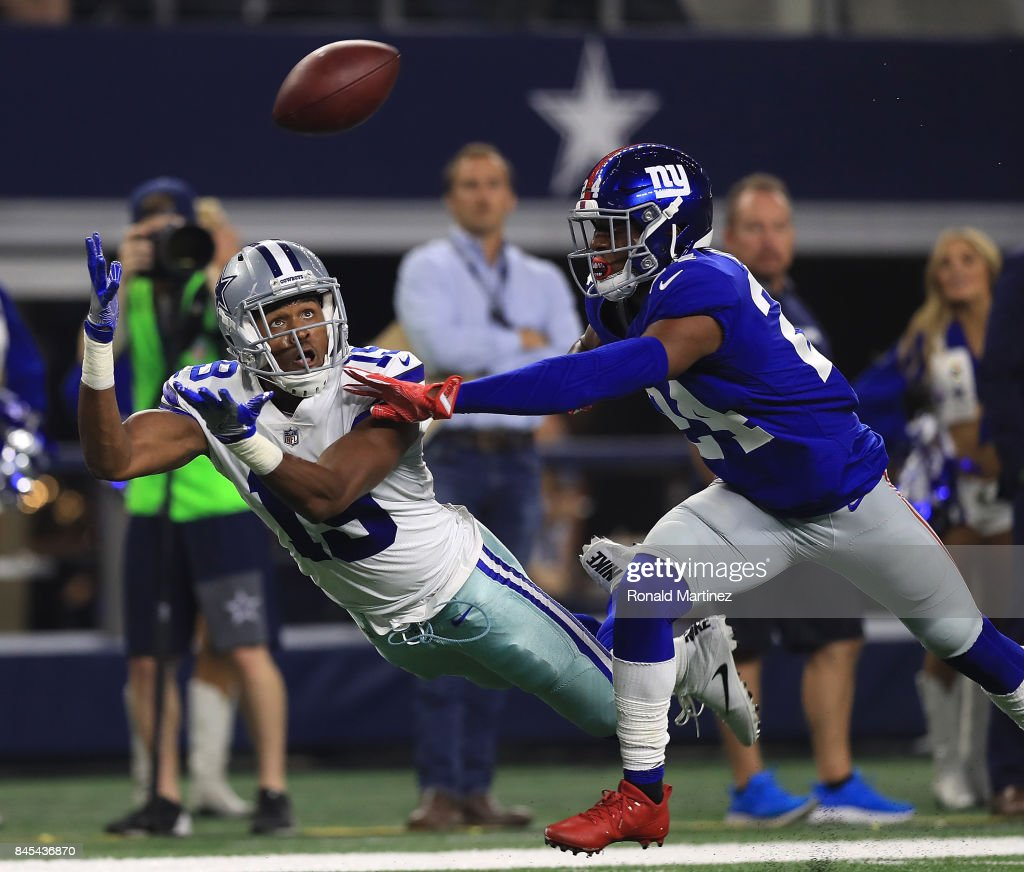 Brice Butler #19 of the Dallas Cowboys dives for a pass against the efforts of Eli Apple #24 of the New York Giants in the first half of a game at AT&T Stadium on September 10, 2017 in Arlington, Texas.