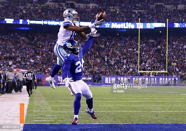 Brice Butler of the Dallas Cowboys misses a catch in the end zone against Eli Apple of the New York Giants during the first half of the game at...