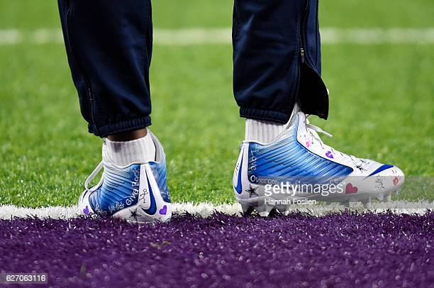 Brice Butler of the Dallas Cowboys wears personalized cleats during pregame warmups before facing the Minnesota Vikings on December 1 2016 at US Bank...