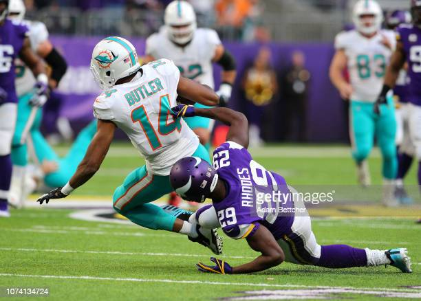 Brice Butler of the Miami Dolphins is tackled with the ball by Xavier Rhodes of the Minnesota Vikings in the second quarter of the game at US Bank...