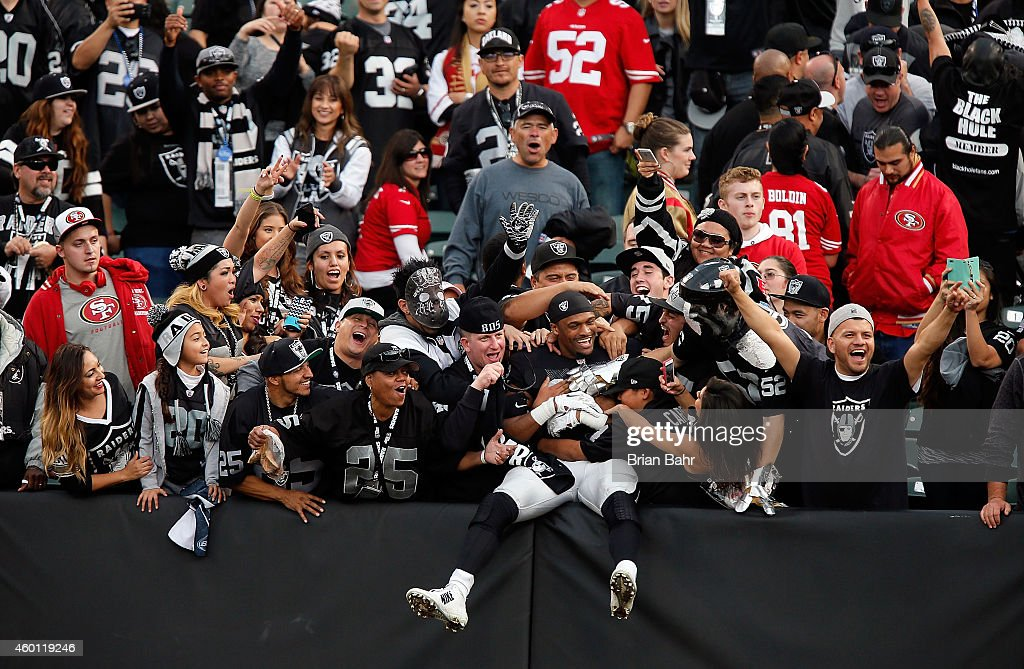 Brice Butler #12 of the Oakland Raiders celebrates with fans after their win against the San Francisco 49ers at O.co Coliseum on December 7, 2014 in Oakland, California.