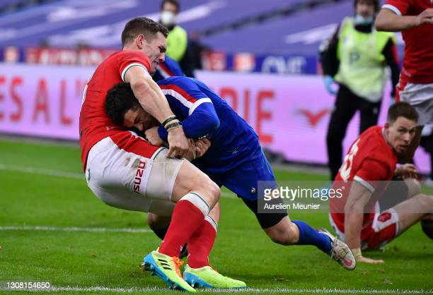 Brice Dulin of France beats George North of Wales to score his sides 3rd Try which is later disallowed for a Neck-Roll resulting in a red card for...