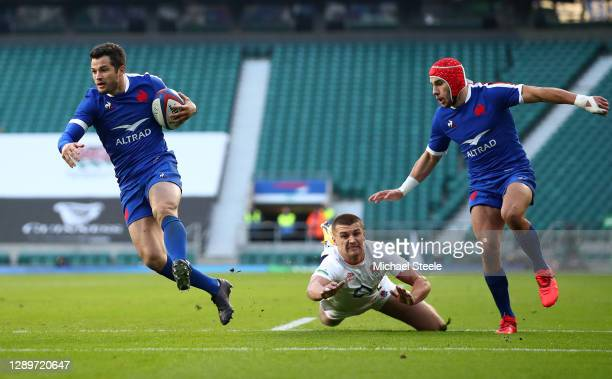 Brice Dulin of France beats Henry Slade of England on the way to scoring their sides first try during the Autumn Nations Cup Final & Quilter...