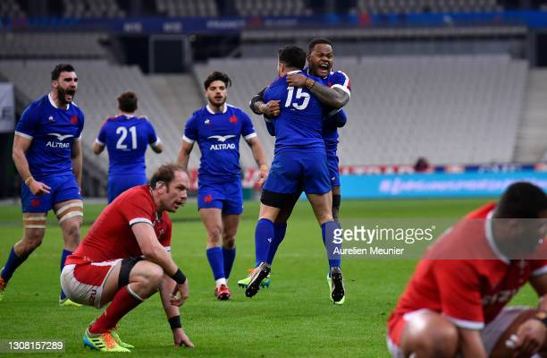 Brice Dulin of France celebrates scoring his sides 4th and winning try with Virimi Vakatawa as Alun Wyn Jones of Wales looks on dejected during the...