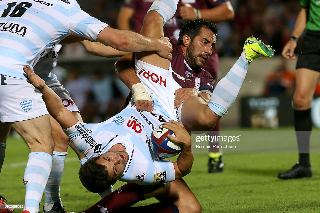 Brice Dulin of Racing 92 is tackled by Louis Benoit Madaule of Union Bordeaux Begles during the French Top 14 union match between Union Bordeaux Begles and Racing 92 at Stade Chaban-Delmas on August 20, 2016 in Bordeaux, France.