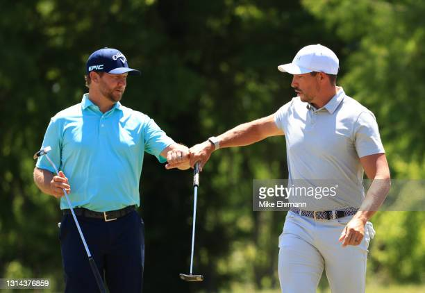 Brice Garnett and Scott Stallings react to a putt on the second green during the final round of the Zurich Classic of New Orleans at TPC Louisiana on...