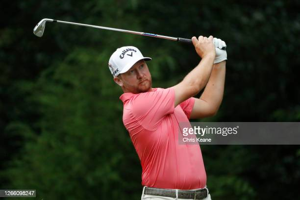 Brice Garnett of the United States plays his shot from the sixth tee during the first round of the Wyndham Championship at Sedgefield Country Club on...