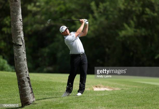 Brice Garnett plays his second shot on the 18th hole during the first round of the Puerto Rico Open at Grand Reserve Country Club on February 25,...