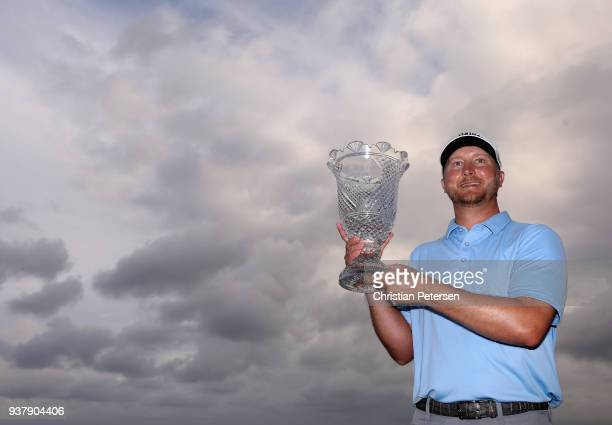 Brice Garnett poses with the trophy after putting in to win on the 18th green during the final round of the Corales Puntacana Resort & Club...