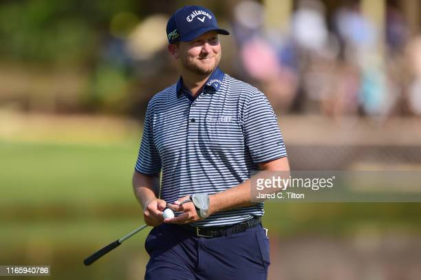 Brice Garnett reacts following a putt on the 15th green during the third round of the Wyndham Championship at Sedgefield Country Club on August 03,...