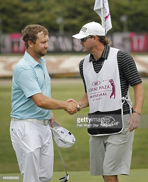 Brice Garnett shakes hands with his caddie after the second round of the Crowne Plaza Invitational at Colonial, in Fort Worth, Texas, Friday May 23,...