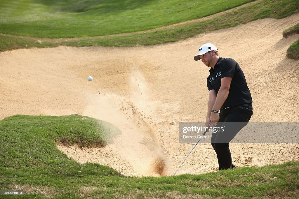 Brice Garnett takes his third shot form the bunker on the 18th during Round One of the Valero Texas Open at the AT&T Oaks Course on March 27, 2014 in San Antonio, Texas.