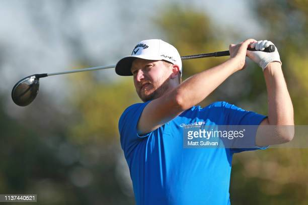 Brice Garnett watches his tee shot on the fourth hole during the first round of the Valspar Championship on the Copperhead course at Innisbrook Golf...