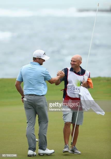 Brice Garnett with his caddie Chris Callas after putting in to win on the 18th green during the final round of the Corales Puntacana Resort & Club...