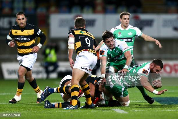 Brice Henderson of Manawatu is tackled during the round two Mitre 10 Cup Ranfurly Shield match between Taranaki and Manawatu at Yarrow Stadium on...
