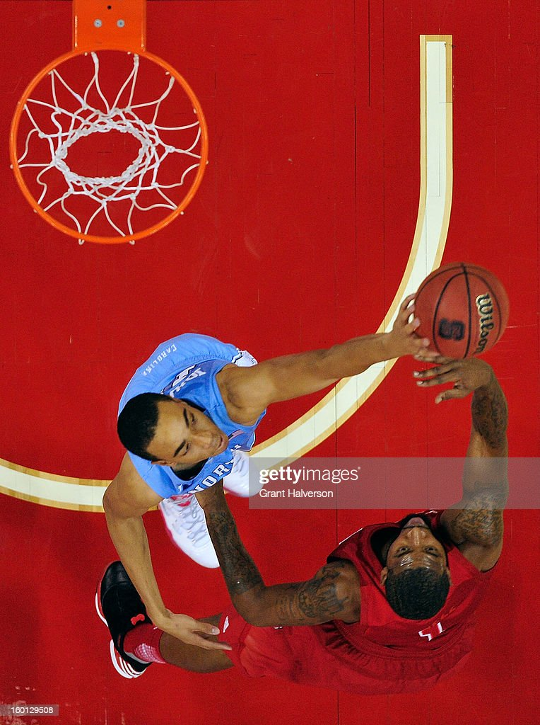 Brice Johnson #11 of the North Carolina Tar Heels blocks a shot by Richard Howell #1 of the North Carolina State Wolfpack during play at PNC Arena on January 26, 2013 in Raleigh, North Carolina. North Carolina State won 91-83.