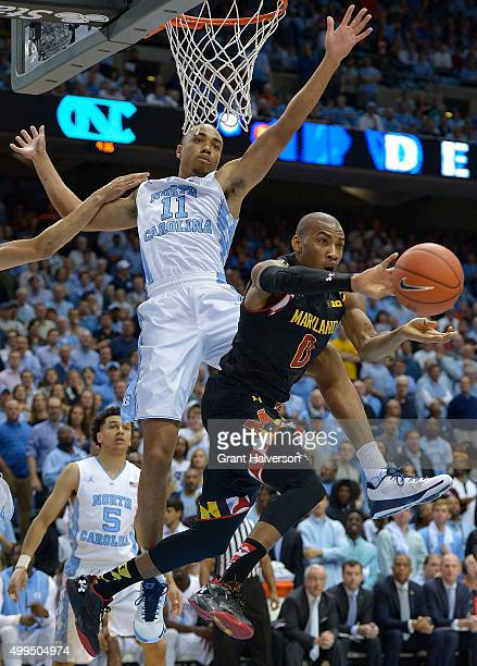 Brice Johnson of the North Carolina Tar Heels defends a drive by Rasheed Sulaimon of the Maryland Terrapins during their game at the Dean Smith...