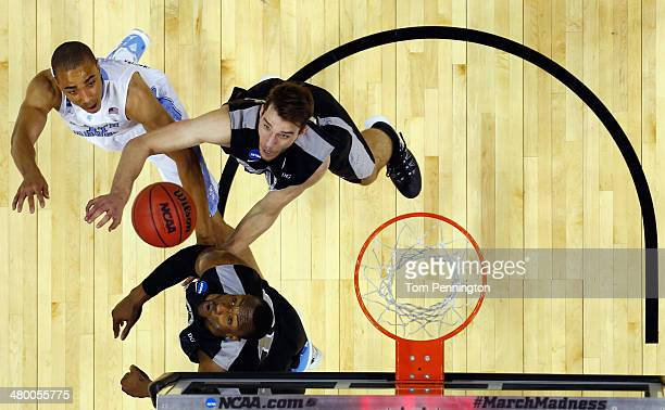Brice Johnson of the North Carolina Tar Heels shoots the ball against Kadeem Batts and Carson Desrosiers of the Providence Friars during the second...