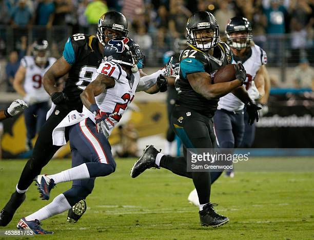 Brice McCain of the Houston Texans attempts to tackle Maurice JonesDrew of the Jacksonville Jaguars during the game at EverBank Field on December 5...