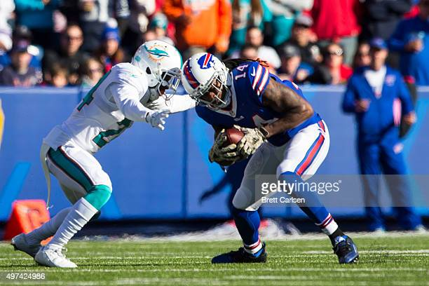 Brice McCain of the Miami Dolphins tackles Sammy Watkins of the Buffalo Bills during the first half on November 8 2015 at Ralph Wilson Stadium in...