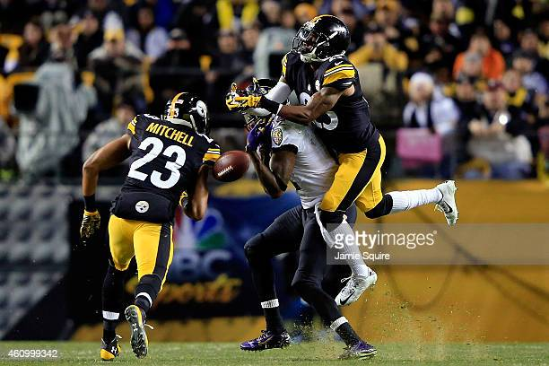 Brice McCain of the Pittsburgh Steelers defends against Jacoby Jones of the Baltimore Ravens during their AFC Wild Card game at Heinz Field on...
