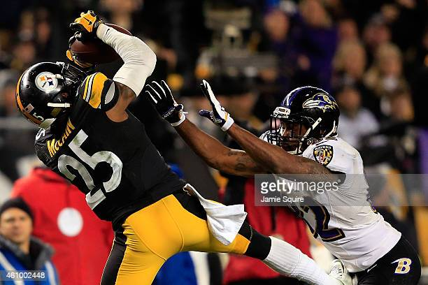Brice McCain of the Pittsburgh Steelers tries to intercept a pass intended for Torrey Smith of the Baltimore Ravens during their AFC Wild Card game...