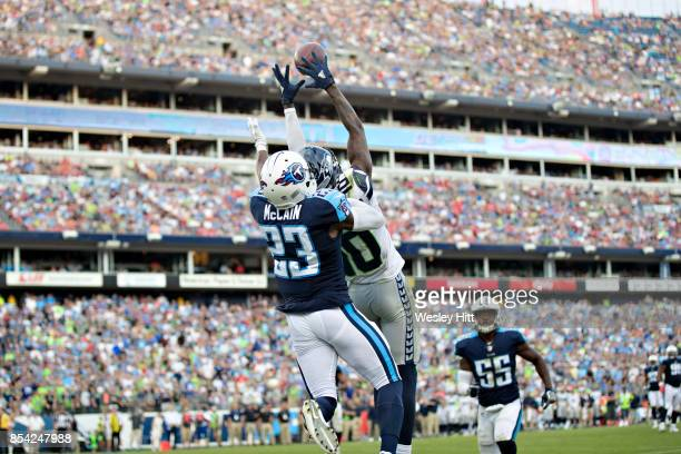 Brice McCain of the Tennessee Titans knocks away a pass thrown into the end zone to Paul Richardson of the Seattle Seahawks at Nissan Stadium on...