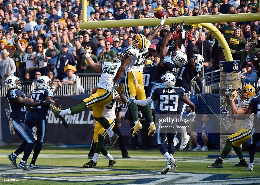 Brice McCain #23 of the Tennessee Titans watches Davante Adams #17 of the Green Bay Packers jump up to try to catch a hail mary pass at the end of the half during the first half at Nissan Stadium on November 13, 2016 in Nashville, Tennessee.