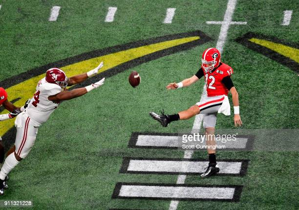 Brice Ramsey of the Georgia Bulldogs punts against the Alabama Crimson Tide in the CFP National Championship presented by ATT at MercedesBenz Stadium...