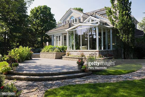 brick and stone cottage style home with sunroom, patio and landscaped backyard, quebec, canada - beautiful house stock photos and pictures
