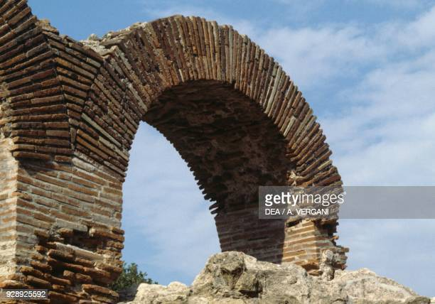 Brick arch ruins of the Temple of Jupiter Cuma Archaeological Park Pozzuoli Campania Italy Roman civilization 4th century BC