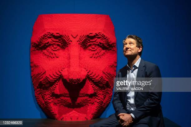"""Brick artist Nathan Sawaya poses by one of his lego sculptures during the """"The Art of The Brick"""" exhibit, April 22, 2021 at the California Science..."""