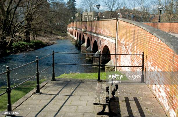 brick bridge over river mole in leatherhead on sunny day - surrey england stock pictures, royalty-free photos & images