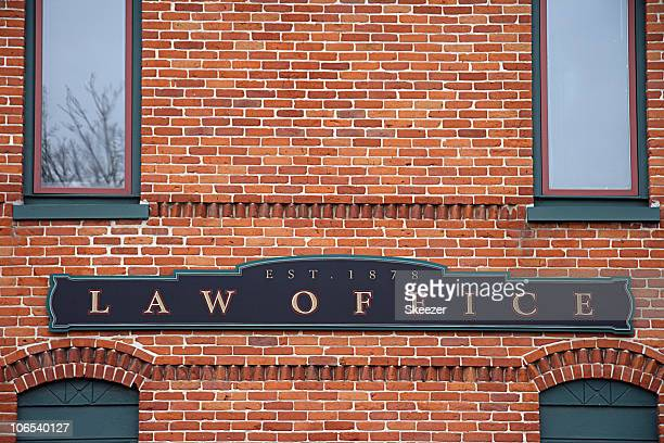 Brick building with a law office sign