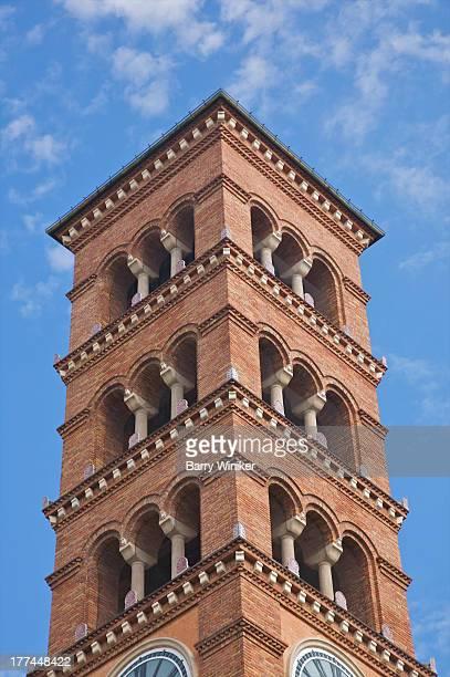 Brick clocktower with Romanesque arches