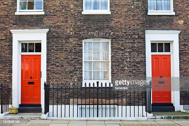 Brick Facade with Red Front Doors London England