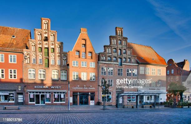 brick facades in lüneburg, germany - lüneburg stock pictures, royalty-free photos & images