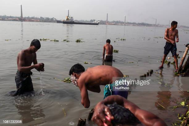 Brick field worker are having bath after his work shift in brickfields Narayanganj near Dhaka Bangladesh on January 12 2019
