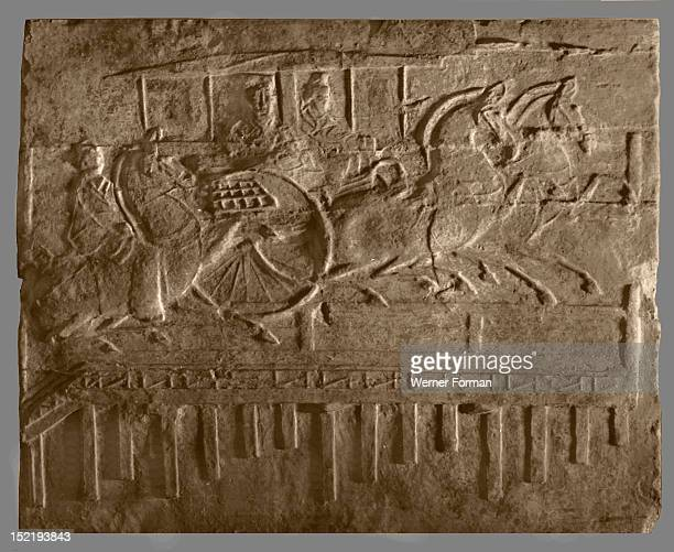 Brick from a tomb structure impressed with horses and carriage crossing a bridge China Date Han dynasty c 300 BC 300 AD Material Brick Credit Werner...