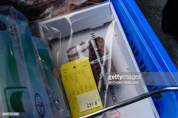 A brick is seen in a box of evidence being delivered to the High Court for the case of proindependence protestors including Edward Leung who are...