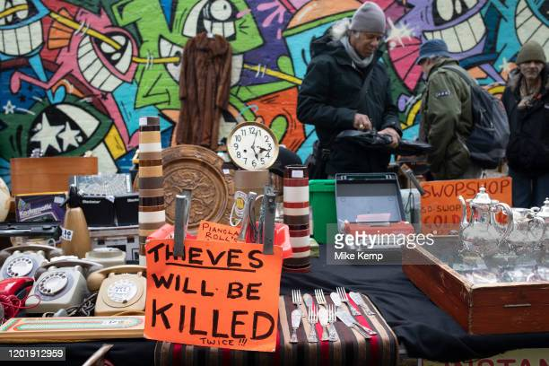 Brick Lane warning sign against theft ' thieves will be killed' on market day on 2nd February 2020 in London, England, United Kingdom. Brick Lane...