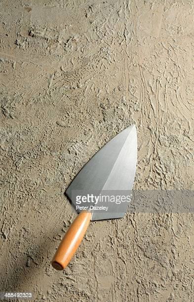 brick layers trowel on concrete background - construction material stock pictures, royalty-free photos & images
