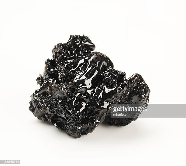 a brick of black tar on a white background - tar stock pictures, royalty-free photos & images