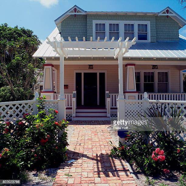brick path leading to white exterior - dana white stock pictures, royalty-free photos & images