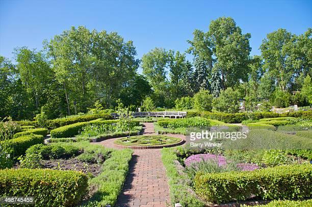 Brick path within formal herb garden