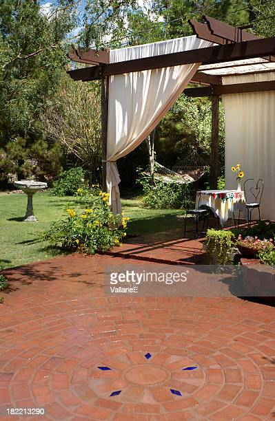 Brick Patio with Canvas Curtains